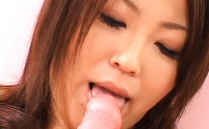 Saki Kataoka starts licking her dildo to lube it up for her pussy