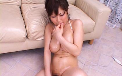 Harumi Asano gets a facial after stroking two guys hard cocks